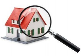 Search_for_homes_magnifyer_and_Red_house
